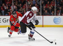 Matt Duchene #9 of the Colorado Avalanche breaks up the ice chased by Brandon Saad #20 of the Chicago Blackhawks at the United Center on January 14, 2014 in Chicago, Illinois. The Avalanche defeated the Blackhawks 3-2 in overtime.(Photo by Jonathan Daniel/Getty Images)