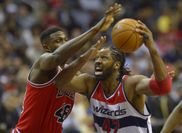 Chicago center Nazr Mohammed (48), defends Washington power forward Nene  (42) going up for a shot as  the Washington Wizards host the Chicago Bulls  at the Verizon Center in Washington DC, January16, 2014. ( Photo by John McDonnell/The Washington Post via Getty Images)