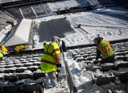 Crews work to remove snow from MetLife Stadium, which will host Superbowl XLVIII next month, on January 22, 2014 in East Rutherford, New Jersey. In what is being called the first ever 'cold weather superbowl,' the Denver Broncos and Seattle Seahawks will face off in front of over 80,000 fans. Cold weather welcome kits have been produced for fans that will include earmuffs, hats, mittens, hand warmers, lip balm, and tissues, among other items. After a snowstorm hit the New York region with a foot