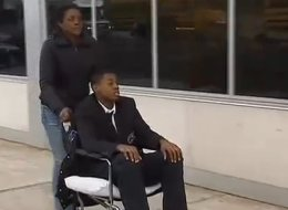 Darrin Manning is wheeled away by his mother after suffering a ruptured testicle.