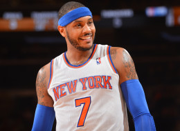 Carmelo Anthony #7 of the New York Knicks smiles against the Philadelphia 76ers during the game on January 22, 2014 at Madison Square Garden in New York City, New York.