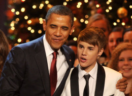 President Barack Obama shakes hands with Justin Bieber onstage during Christmas in Washington 2011 at the National Building Museum on December 11, 2011 in Washington, DC.  21980_004_0457.JPG