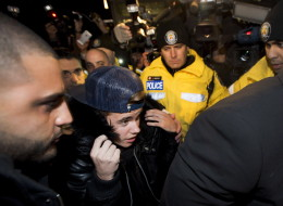 Justin Bieber arrives at a Toronto Police station to face assault charges. (Nathan Denette/CP)