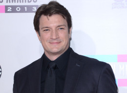 Actor Nathan Fillion arrives at the 2013 American Music Awards at Nokia Theatre L.A. Live on November 24, 2013 in Los Angeles, California.  (Photo by C Flanigan/Getty Images)