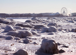 A Ferris wheel on Navy Pier rises above ice along the shore of Lake Michigan on January 28, 2014 in Chicago, Illinois. (Photo by Scott Olson/Getty Images)