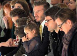 David Beckham sits with his daughter Harper as models present the fashions of Victoria Beckham during the Mercedes-Benz Fashion Week Fall/Winter 2014 shows Feb. 9 in NYC.