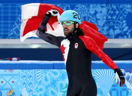 Gold medalist Charles Hamelin of Canada celebrates after wiining the Short Track Men's 1500m Final on day 3 of the Sochi 2014 Winter Olympics at Iceberg Skating Palace on February 10, 2014 in Sochi, Russia.  (Photo by Streeter Lecka/Getty Images)