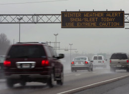 A travel advisory sign along I-85 South warns drivers of hazardous driving conditions as a winter storm approaches on February 11, 2014 in Atlanta, Georgia.