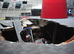 A sinkhole opened inside the National Corvette Museum and swallowed 8 cars Wednesday.