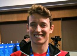 Canadian snowboarder Michael Lambert wasn't afraid to express his opinions about the cost and controversy surrounding this year's Winter Games when he spoke to reporters Sunday.