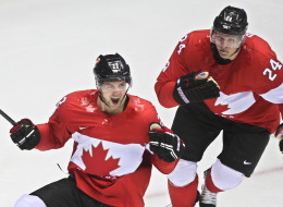 Jamie Benn scores the first goal of the Canada vs. USA Olympic hockey game and celebrates with Corey Perry. (Getty)