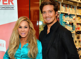 Adrienne Maloof (L) and her boyfriend Jacob Busch appear at GNC Beverly Center to promote 'Never Hungover' elixir at GNC at The Beverly Center on February 27, 2014 in Los Angeles, California.  (Photo by Amanda Edwards/Getty Images)