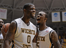 Chadrack Lufile #0 and Nick Wiggins #15 of the Wichita State Shockers react after a score against the Missouri State Bears during the first half on March 1, 2014 at Charles Koch Arena in Wichita, Kansas.  (Photo by Peter Aiken/Getty Images)