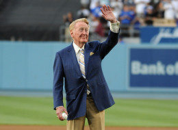 Legendary Dodger Broadcaster Vin Scully throws out ceremonial first pitch at Dodger Stadium on August 30, 2012 in Los Angeles, California.  (Photo by Mark Sullivan/WireImage)