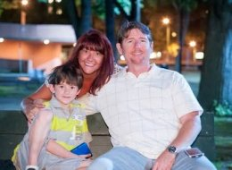 Cathy O'Grady (center) shares the joy of giving back with her son, Matthew, and husband, Brian.