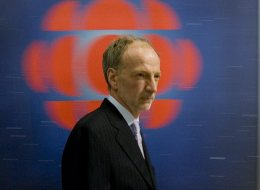 Canadian Broadcasting Corp. president and CEO Hubert Lacroix walks past their logo between meetings at their office, in Ottawa Monday Nov 5, 2007. (THE CANADIAN PRESS/Tom Hanson)