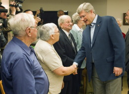 Prime Minister Stephen Harper geets seniors at a campaign event in Riviere du Loup, Quebec on Wednesday April 20, 2011. THE CANADIAN PRESS/Frank Gunn