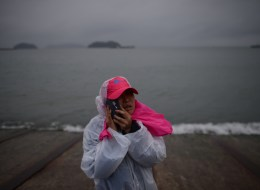 A relative waits on a pier in Jindo on April 17, 2014, as the frantic search for nearly 300 people, most of them schoolchildren, missing after a South Korean ferry capsized extended into a second day, as distraught relatives maintained an agonising vigil on shore. Heart-wrenching messages of fear, love and despair, sent by high school students from a sinking South Korean ferry added extra emotional weight on April 17 to a tragedy that has stunned the entire nation.    AFP PHOTO / ED JONES