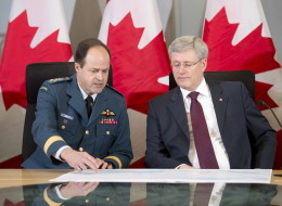 Prime Minister Stephen Harper says Canada will contribute six CF-18 jet fighters to a NATO air-policing mission as a response to the crisis in the Ukraine. (CP)