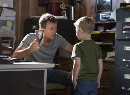 Greg Kinnear, left, and Connor Corum in a scene from