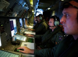 AT SEA - APRIL 11:  Crew members of a Royal New Zealand Air Force P-3 Orion operate radar and sensor systems during the search to locate missing Malaysia Airways Flight MH370 at sea over the Indian Ocean on April 11, 2014 off the coast of Western Australia. Search and rescue officials in Australia are confident they know the approximate position of the black box recorders from missing Malaysia Airlines Flight MH370, Australian Prime Minister Tony Abbott said on Friday. At the same time, however,