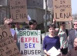Lena Sclove stands with student supporters on Brown University's campus Tuesday speaking about how the school handled her sexual assault case.