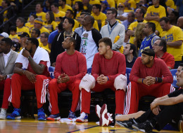 Los Angeles Clippers players sit on the bench wearing their warm-up tops inside out against the Golden State Warriors in Game Four of the Western Conference Quarterfinals during the 2014 NBA Playoffs at ORACLE Arena on April 27, 2014 in Oakland, California.