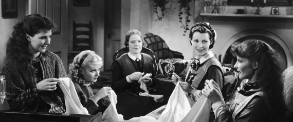 American actresses Jean Parker, Joan Bennett (1910 - 1990), Spring Byington (1886 - 1971), Frances Dee (1909 - 2004), and Katharine Hepburn (1907 - 2003) sew in character on set as the March women in a still from an adaptation of Louisa May Alcott's book 'Little Women' directed by George Cukor, 1933. (Photo by RKO Pictures/Courtesy of Getty Images) | RKO Pictures via Getty Images