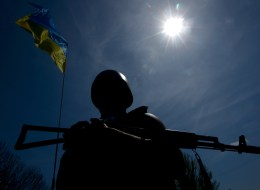 An Ukrainian soldier guards a checkpoint on the road about 25 km from the eastern Ukrainain city of Slavyansk on April 27, 2014. (KIRILL KUDRYAVTSEV/AFP/Getty Images)