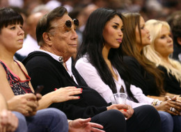 SAN ANTONIO, TX - MAY 19:  (2nd L) Team owner Donald Sterling of the Los Angeles Clippers and V. Stiviano watch the San Antonio Spurs play against the Memphis Grizzlies during Game One of the Western Conference Finals of the 2013 NBA Playoffs at AT&T Center on May 19, 2013 in San Antonio, Texas. (Photo by Ronald Martinez/Getty Images)