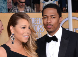 LOS ANGELES, CA - JANUARY 18:  Singer Mariah Carey and Husband Nick Cannon arrive at the 20th Annual Screen Actors Guild Awards at The Shrine Auditorium on January 18, 2014 in Los Angeles, California.  (Photo by C Flanigan/Getty Images)