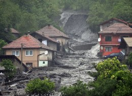 A view of a landslide and floodwaters around houses in the village of Topcic Polje, near the central Bosnian town of Zenica, on May 15, 2014.