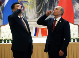 President of Russia Vladimir Putin and Chinese President Xi Jinping toast with vodka during a signing ceremony on May 21, 2014 in Shanghai, China. Russia and China signed a thirty-year contract for supply of gas. (Photo by Sasha Mordovets/Getty Images)