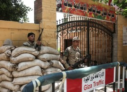 Prior to the presidential elections in Cairo on May 26, the army takes extra security precautions around the voting points, May 25, 2014. (Photo by Ahmed Ismail/Anadolu Agency/Getty Images)