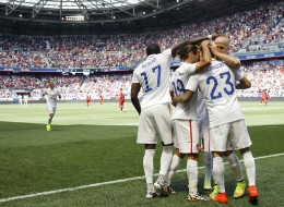 United States' Fabian Johnson (23) is congratulated by teammates after scoring a goal against Turkey in the first half of an international friendly soccer match on Sunday, June 1, 2014, in Harrison, N.J. (AP Photo/Julio Cortez)
