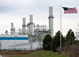 A U.S. flag flies in front of a natural gas-fired power plant in Minooka, Illinois.