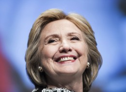 Former Secretary of State Hillary Clinton smiles before speaking at the World Bank May 14, 2014 in Washington, DC. (BRENDAN SMIALOWSKI/AFP/Getty Images)