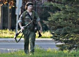 A man identified by police as Justin Bourque is seen in Moncton on Wednesday.