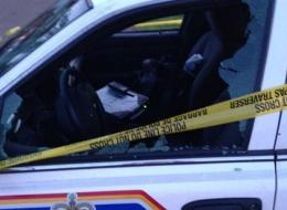 Disturbing photos submitted to The Huffington Post Canada from the manhunt in Moncton, N.B. showed smashed windows and a trail of red liquid that looked like blood on a street.
