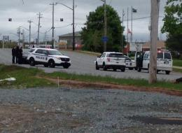 A salvage yard in Dartmouth, Nova Scotia is surrounded by police following reports of an armed man.