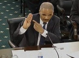 Attorney General Eric Holder gives the Boy Scout oath during testimony before Congress earlier this year. (Photo: House.gov)