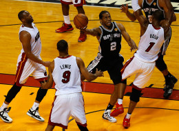 Kawhi Leonard #2 of the San Antonio Spurs goes to the basket against Chris Bosh #1 of the Miami Heat during Game Three of the 2014 NBA Finals at American Airlines Arena on June 10, 2014 in Miami, Florida. NOTE TO USER: User expressly acknowledges and agrees that, by downloading and or using this photograph, User is consenting to the terms and conditions of the Getty Images License Agreement.  (Photo by Chris Trotman/Getty Images)