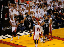 Tim Duncan #21 of the San Antonio Spurs dunks against the Miami Heat during Game Four of the 2014 NBA Finals at American Airlines Arena on June 12, 2014 in Miami, Florida. NOTE TO USER: User expressly acknowledges and agrees that, by downloading and or using this photograph, User is consenting to the terms and conditions of the Getty Images License Agreement.  (Photo by Chris Trotman/Getty Images)