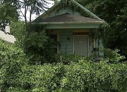 A boy found a mummified corpse hanging in this Dayton, Ohio home Sunday.