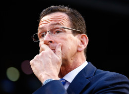 BOSTON, MA - APRIL 22: Connecticut governor Dannel Malloy talks with members of the national champion Connecticut Huskies men's basketball tem prior to the game between the Boston Red Sox and the New York Yankees at Fenway Park on April 22, 2014 in Boston, Massachusetts.  (Photo by Jared Wickerham/Getty Images)