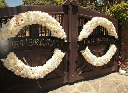 LOS OLIVOS, CA - JUNE 28:  Wreaths hanges on the entrance at Michael Jackson's Neverland Ranch on June 28, 2009 in Los Olivos, California.  (Photo by Alberto E. Rodriguez/Getty Images)
