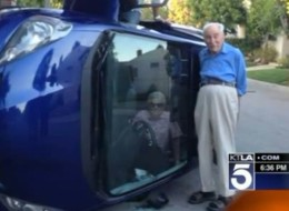 Benjamin Neufeld stands next to his wife Elizabeth who's trapped in their car after flipping it near their Los Angeles home. Elizabeth was unharmed.