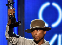 Singer Pharrell Williams accepts Video of the Year for 'Happy' onstage during the BET AWARDS '14 at Nokia Theatre L.A. LIVE on June 29, 2014 in Los Angeles.  (Photo by Kevin Winter/Getty Images for BET)