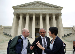 WASHINGTON, DC - APRIL 22:  Aereo Vice President of Communications and Government Relations Virginia Lam (R) turns down a question from a member of the media (L) as Aereo CEO Chet Kanojia (2nd L) leaves the U.S. Supreme Court after oral arguments April 22, 2014 in Washington, DC. The Supreme Court heard arguments in a case against Aereo on the companys profiting from rebroadcasting network TVs programs obtained from public airwaves.  (Photo by Alex Wong/Getty Images)