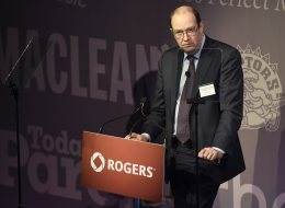 Guy Laurence, the new president and CEO of Rogers Communications, speaks at the company's annual general meeting in Toronto on April 22 2014. Rogers Communications says from now on it will require police to get a warrant before it hands over subscriber data.